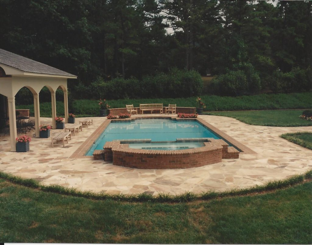 Located in Anderson, SC, is a rectangular gunite pool with a raised spa. It features brick coping and a flagstone deck.