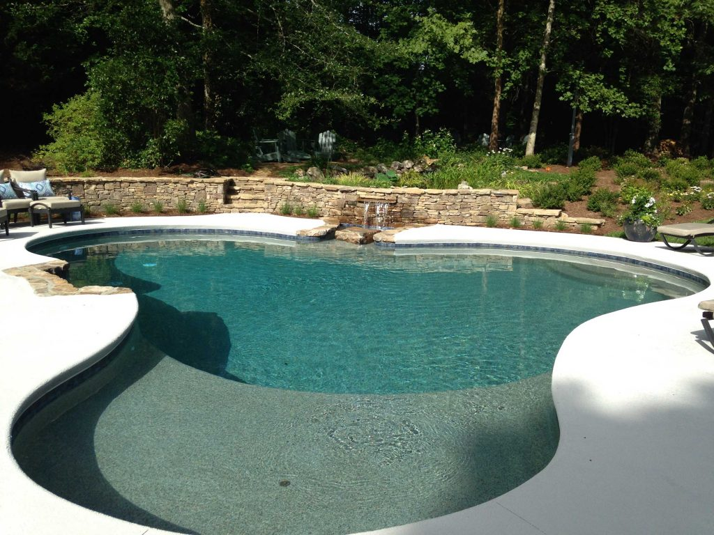 Located in Greenville, SC, is a free form gunite pool. It features a Caribbean Blue Pebble Tec and a stacked rock waterfall.